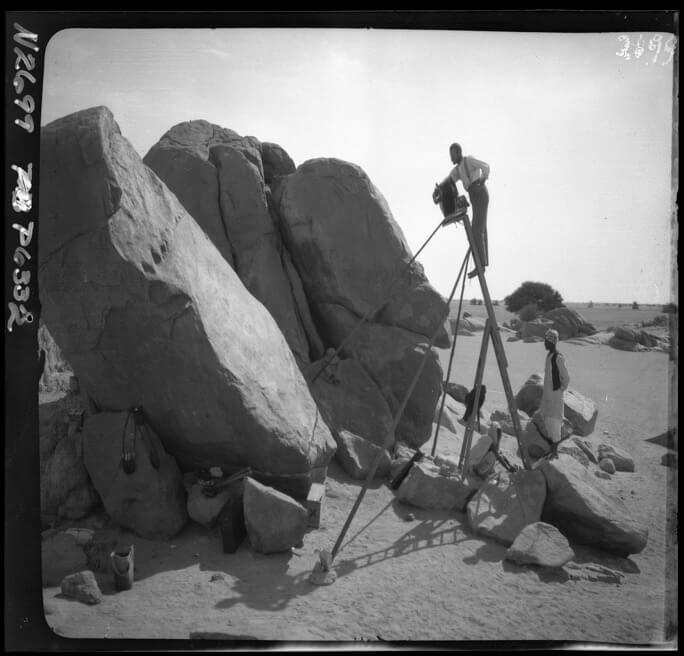 Members of the 1906-7 Chicago expedition taking photographs of inscriptions at Tumbos that record the victory of Egyptian King Thutmosis I over the Nubians (Copyright Oriental Institute of the University of Chicago)