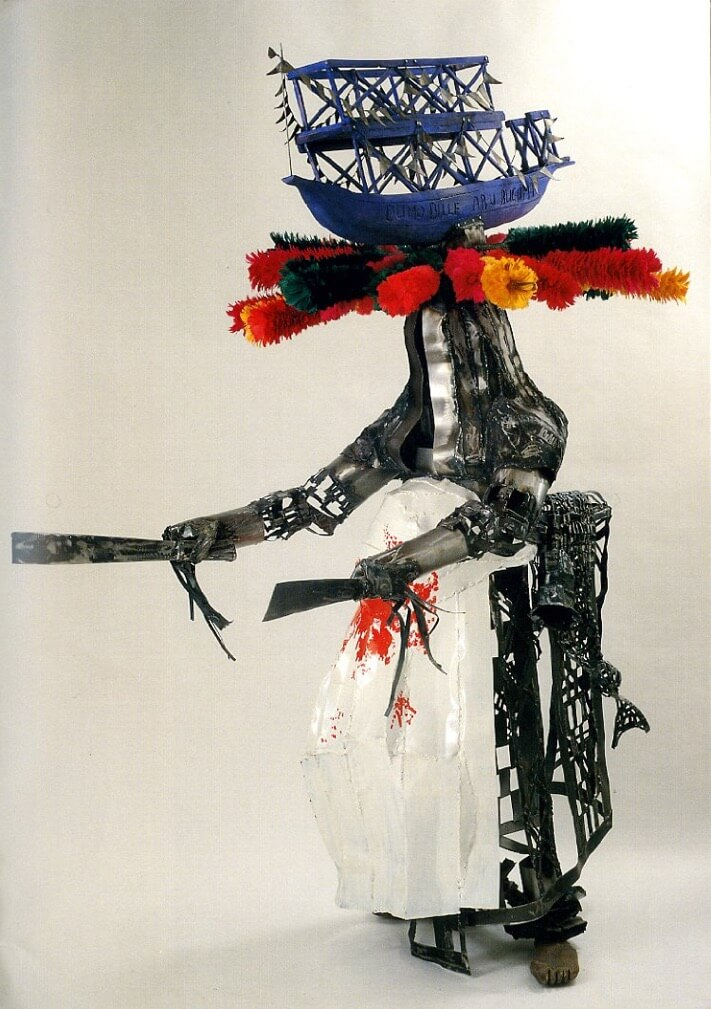 Big Masquerade with boat and household on his head—a version of the Okolokurukuru masquerade—by Sokari Douglas Camp, 1995. Steel, feather, textile and wood.